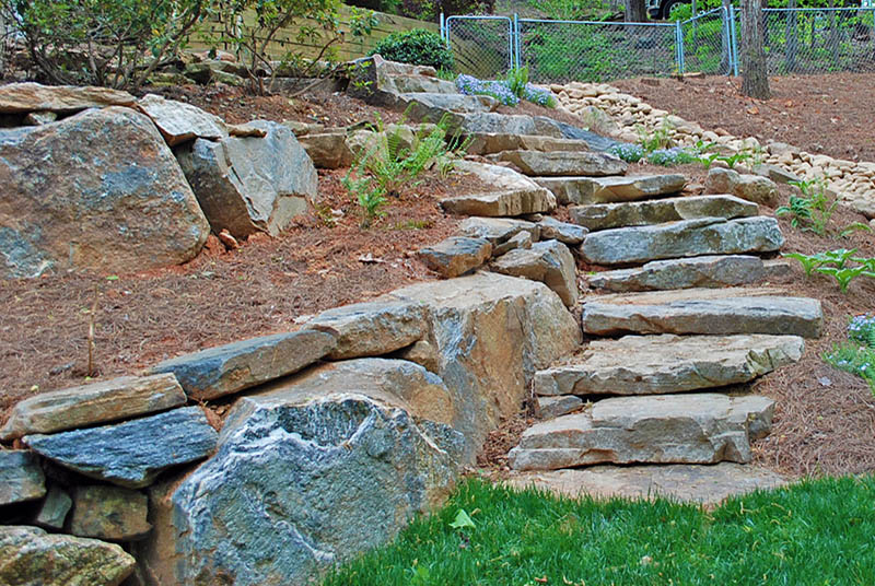 boulder retaining wall with stairs